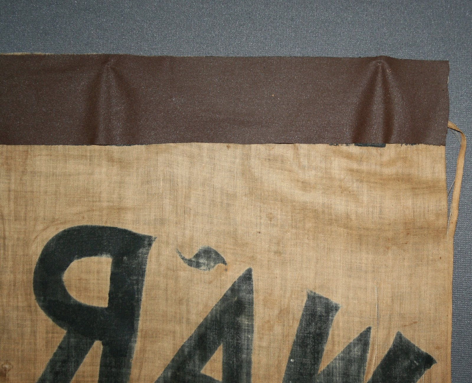 old repair to civil war banner, art conservator needed, preservation repair and conservation of historic textile