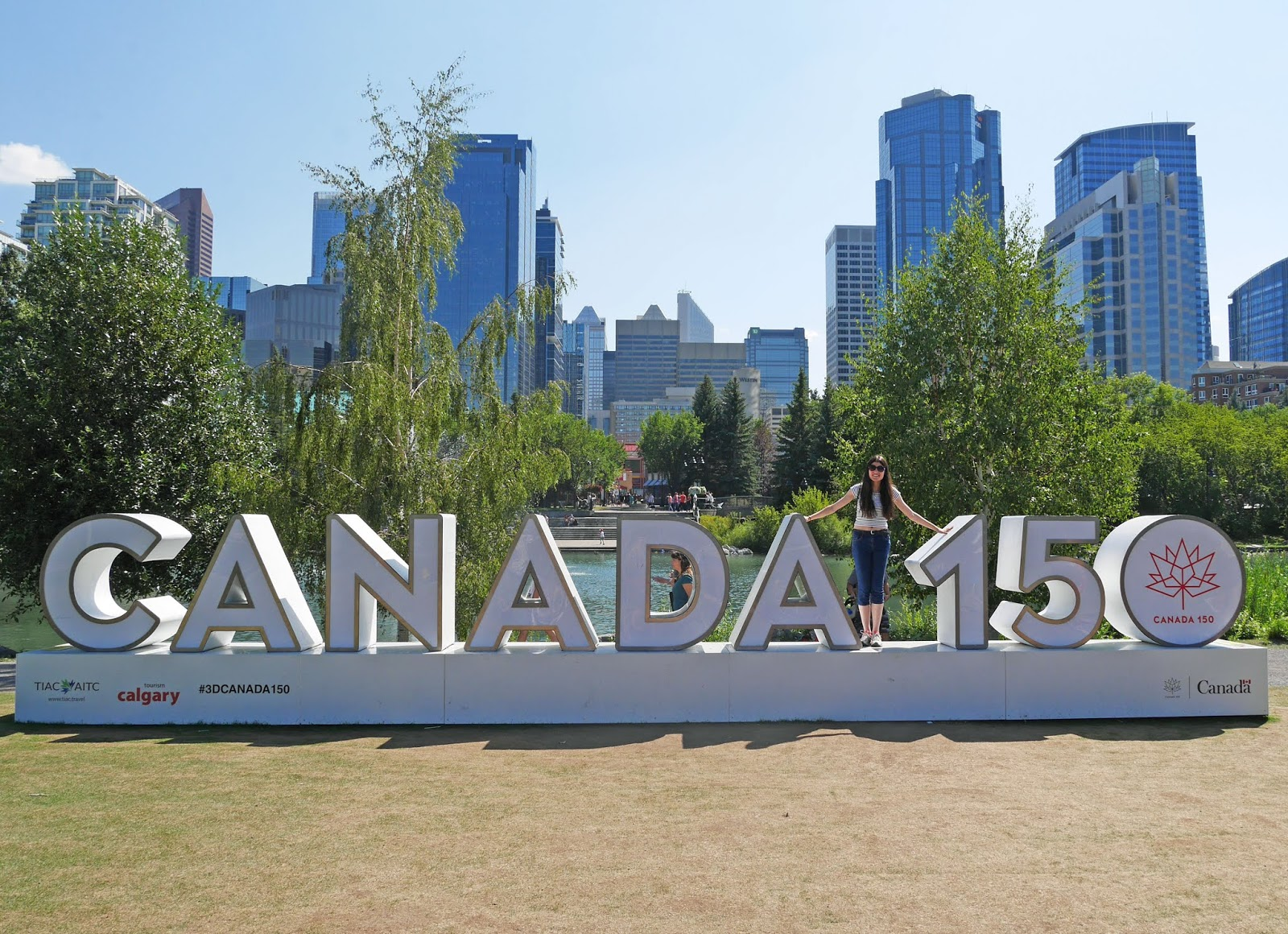 Kat Last standing on the Canada 150 sign at Prince's Island Park, Calgary