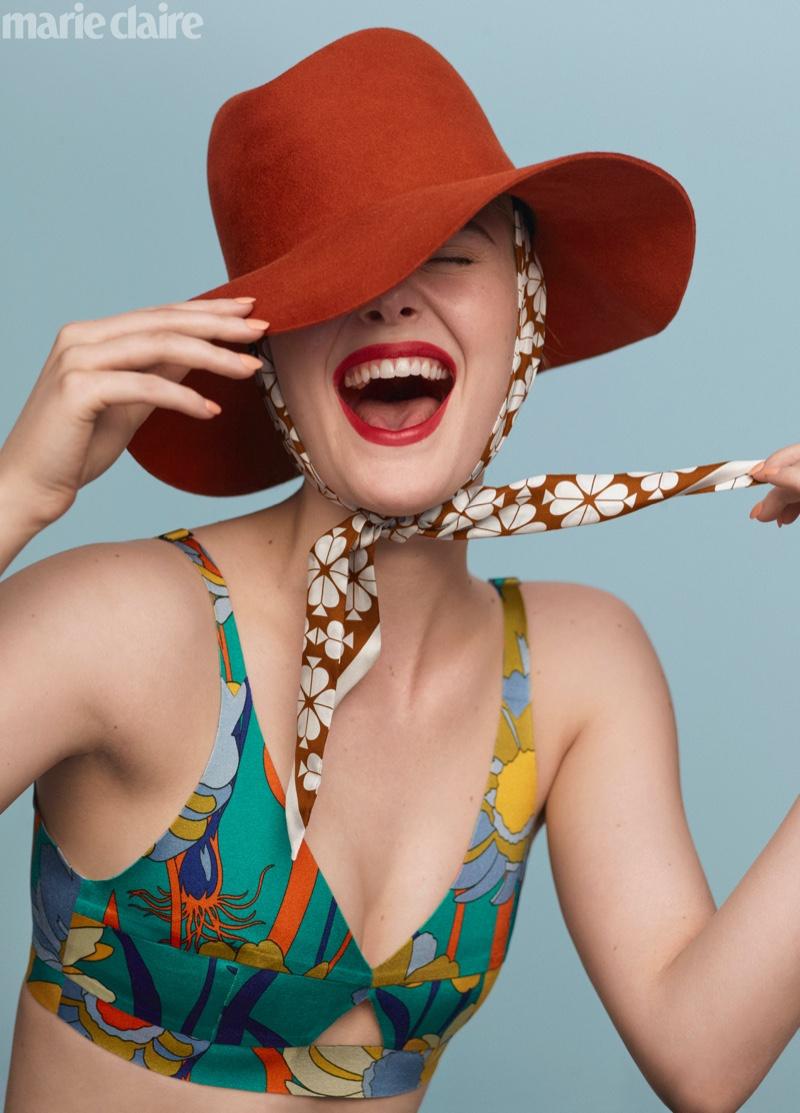 Actress Elle Fanning wears Fendi top, Janessa Leoné hat and Kate Spade scarf