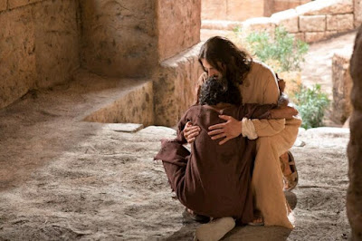 Jesus with a man.