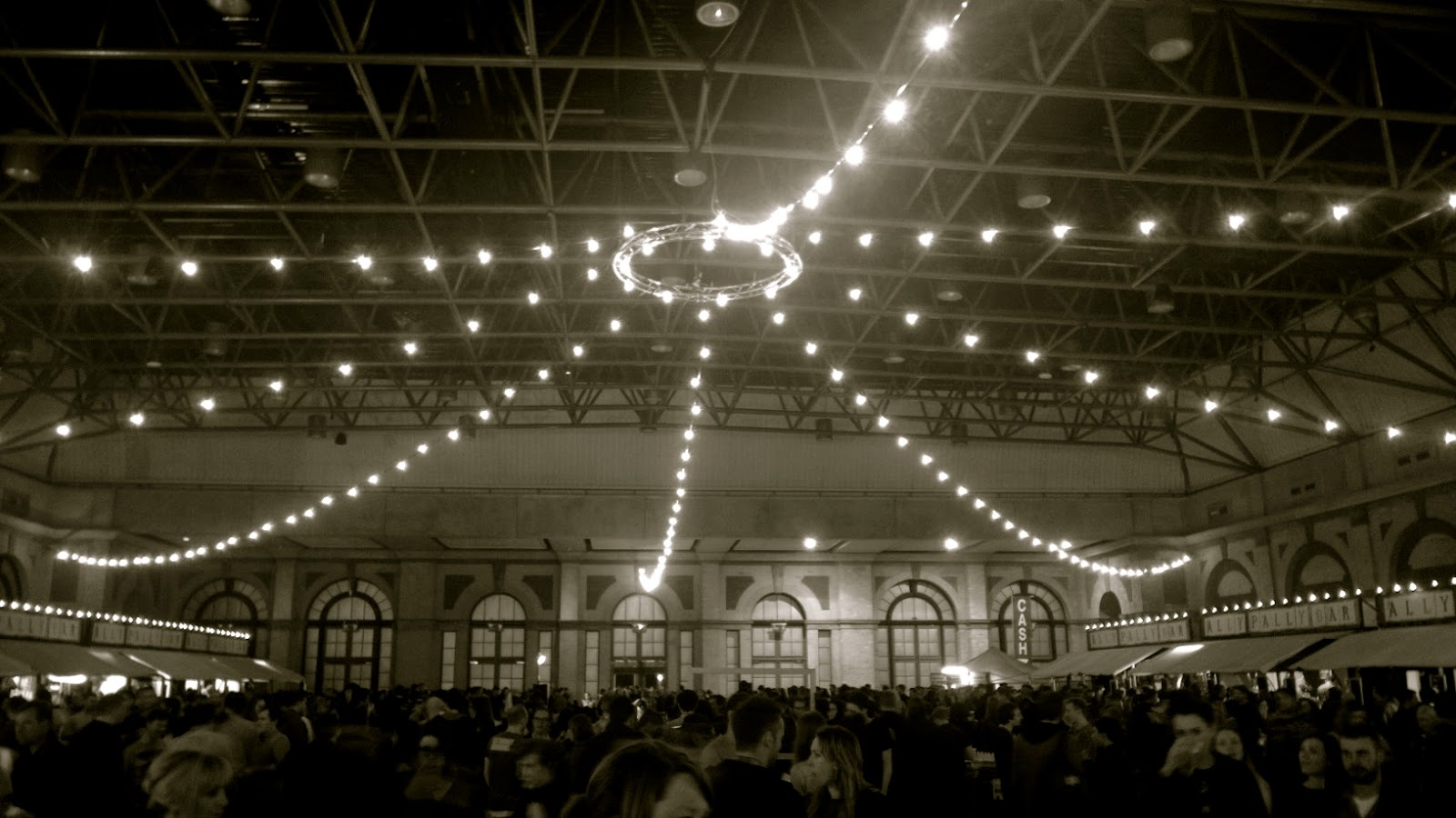 The food hall at Alexandra Palace with lights on the ceiling