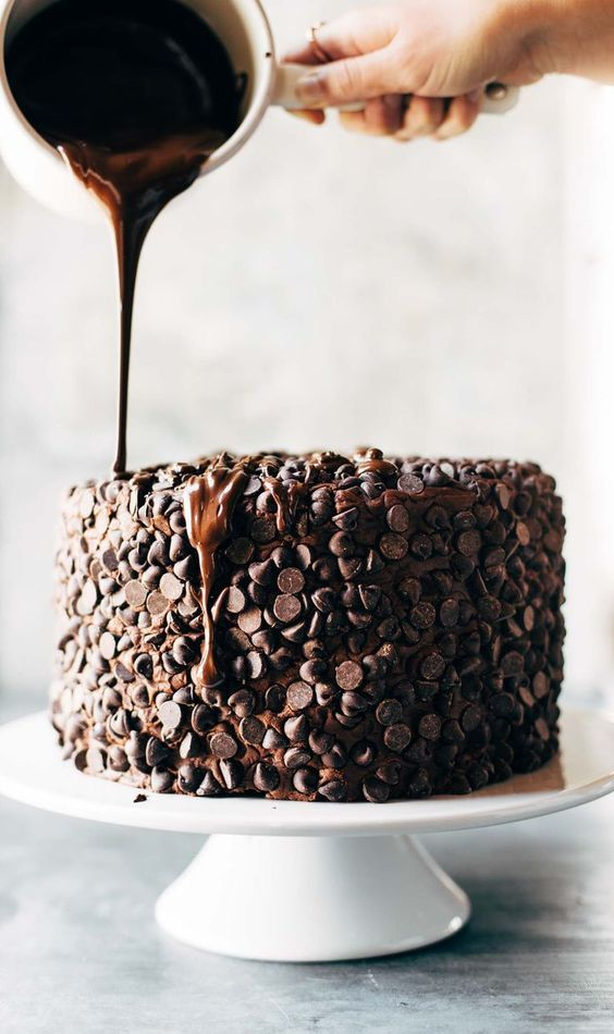 Blackout Chocolate Cake - This is the cake for chocolate lovers! Ultramoist chocolate cake, layers of cream cheese chocolate frosting, and an awesome chocolate chip + chocolate drizzle exterior. Recipe based off of this solid Chocolate Blackout Cake from Life Made Simple.