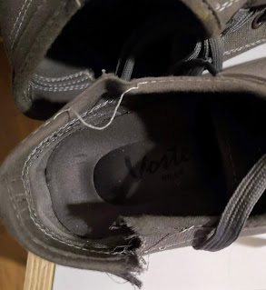 A close-up of damage my Vostey Canvas Sneakers sustained after attempting to put them on