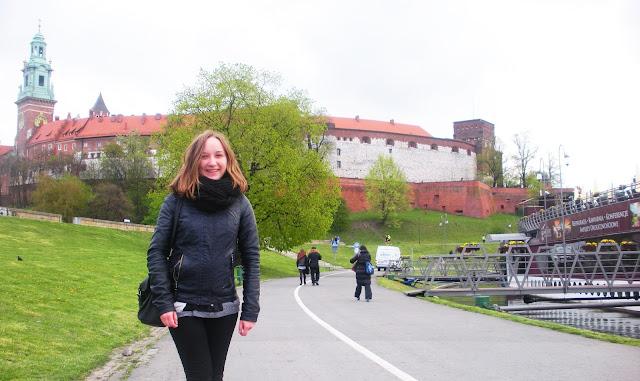 Girl in front of Wawel Castel in Krakow.