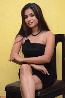 Vrushali Gosavi in strapless Short Black Dress At Follow Follow U Audio Launch 010.JPG