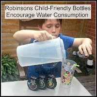 Boy pouring from a Robinsons Squash'd bottle with title overlaid.