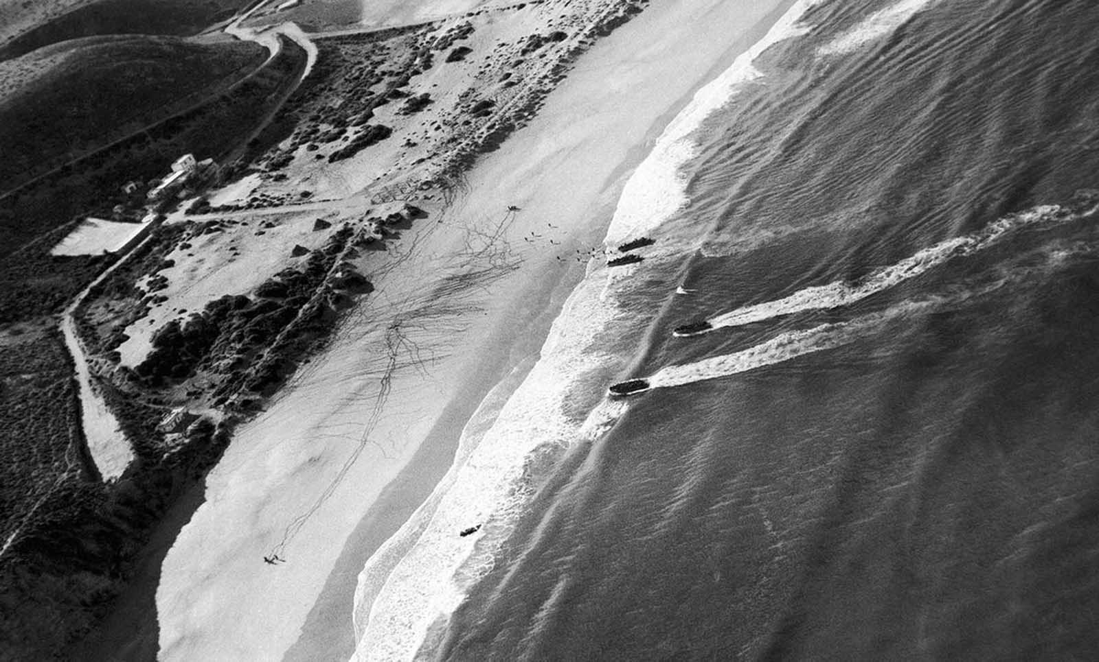 Allied troops land and follow the spider webs of footprints left by first parties near Casablanca, French Morocco, in November of 1942.
