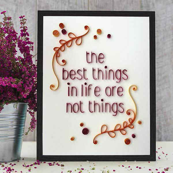 framed on-edge lettered phrase, the best things in life are not things