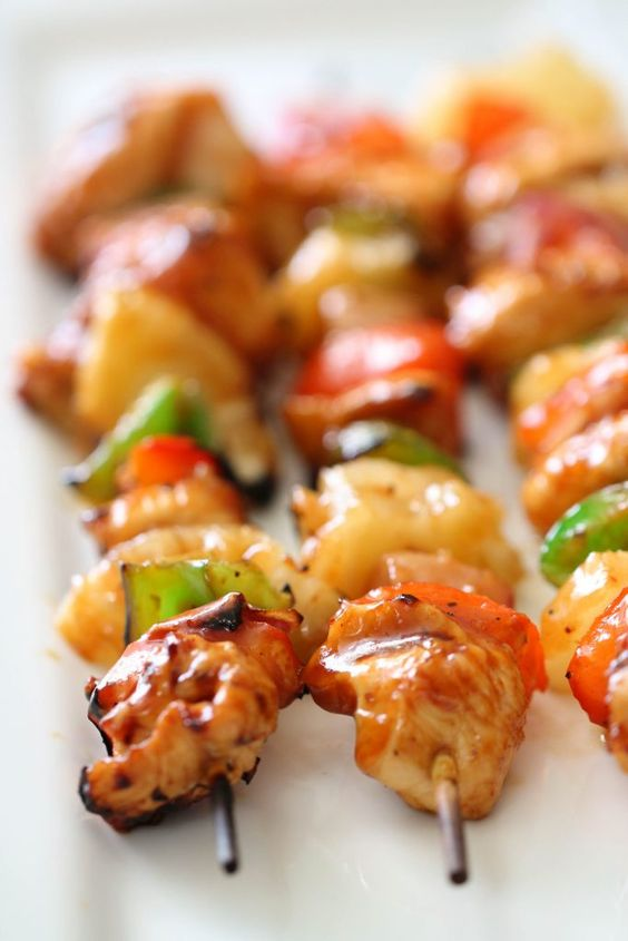 These Hawaiian BBQ Chicken Kabobs have chicken, fresh pineapple, peppers and onions grilled and basted in a sweet and tangy barbecue glaze. The perfect recipe for your summer grilling - serve with a side of white rice and additional sauce for an amazing dinner.