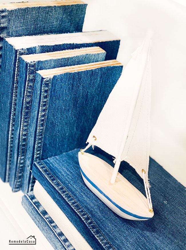 books made from wood and covered with jean fabric