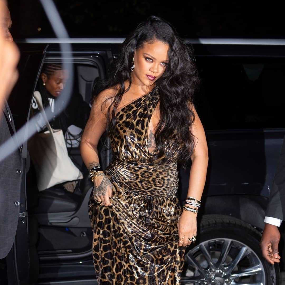 Rihanna shows off her wild side in a leopard print dress as she arrives at her new autobiography release party
