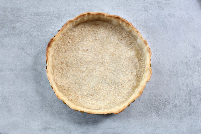 Partially baked pie crust with bread crumbs
