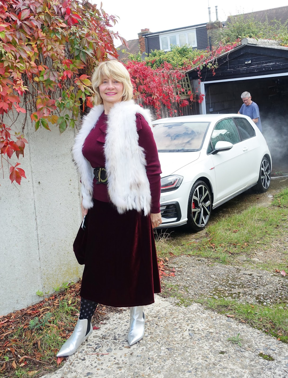 Style blogger Gail Hanlon in burgundy and white with silver boots and Brocatelle tights by Cecilia de Rafael