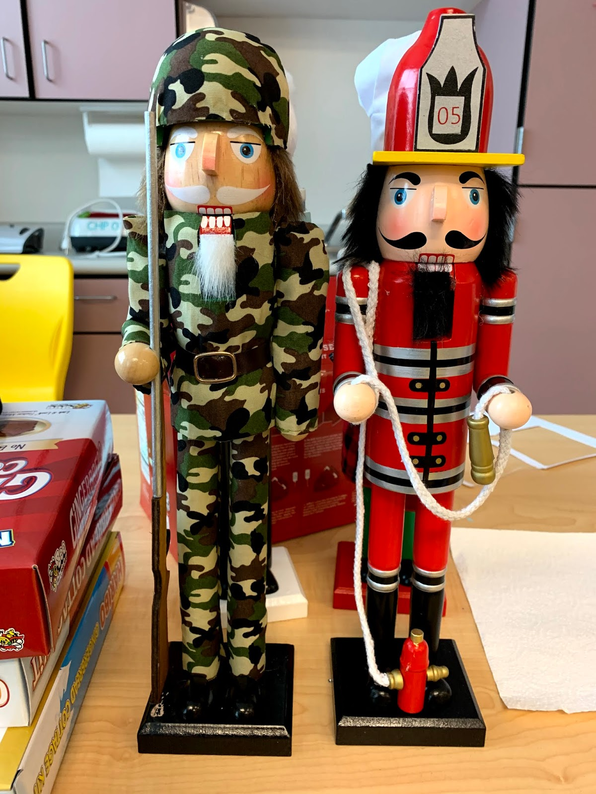 An army and firefighter Nutcracker dolls