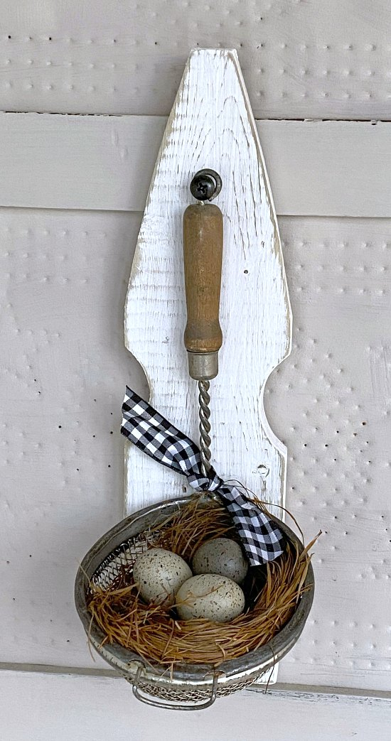 vintage strainer with eggs and bow