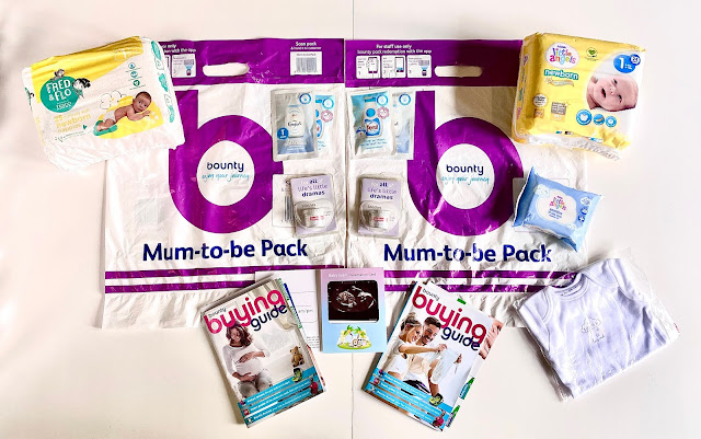 The contents of the Bounty packs from Tesco and Asda side by side with a scan photo in between. Both packs include nappies, a buying guide, sachets of washing liquid, sudocrem, but Asda includes a small packet of wipes and a baby vest too.