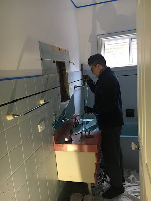 Bathroom Renovations - Removing the Old Mirror