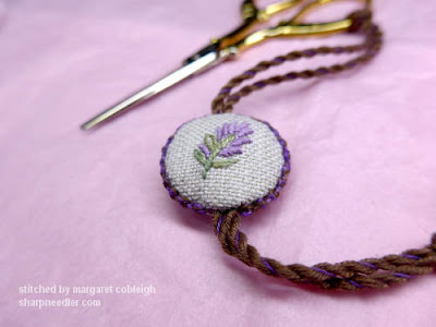 Embroidered lavender spray on one side of the completed fob.