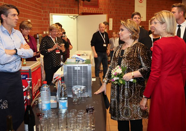 Grand Duchess Maria Teresa visited the 71st Red Cross Bazaar held at Victor Hugo Hall in Luxembourg. printed coat
