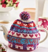 http://www.letsknit.co.uk/free-knitting-patterns/home-sweet-home-teacosy