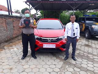 Pengiriman mobil Honda ke alamat: Kampung Teriti, Banjarsari, Sukatani, Kabupaten Bekasi Type Mobil Honda Jazz RS Warna Rally Red