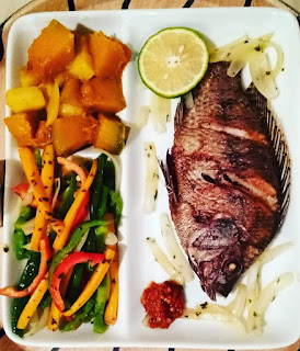 Fresh fried fish with Potatoes and pumpkin and fried vegetables