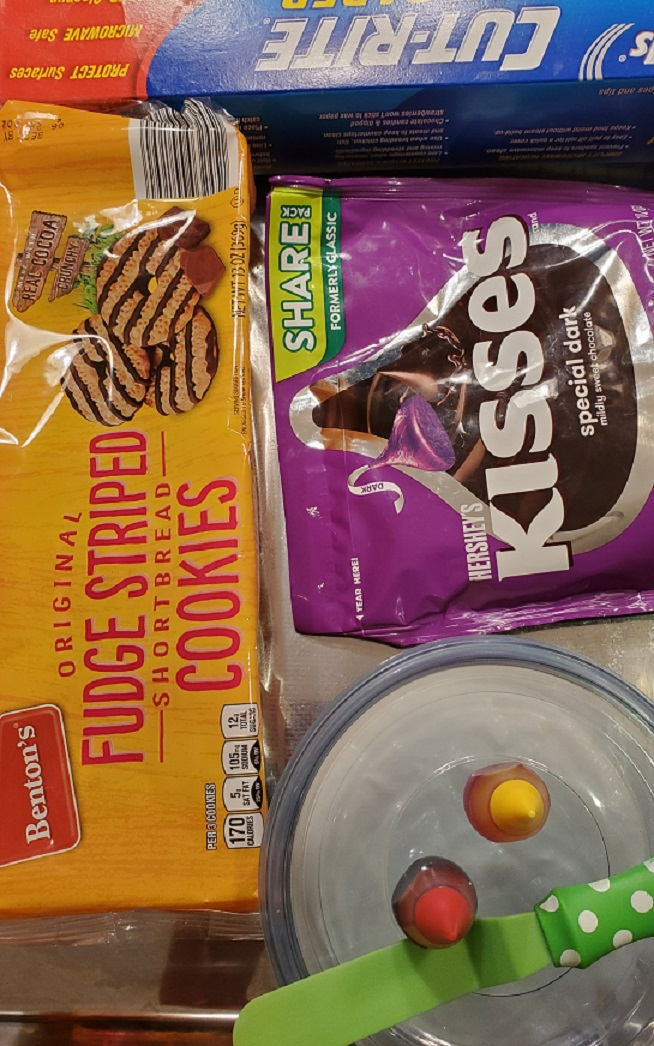 this is the ingredients using store bought fudge stripped cookies and hersheys kisses to make witch hats for Halloween