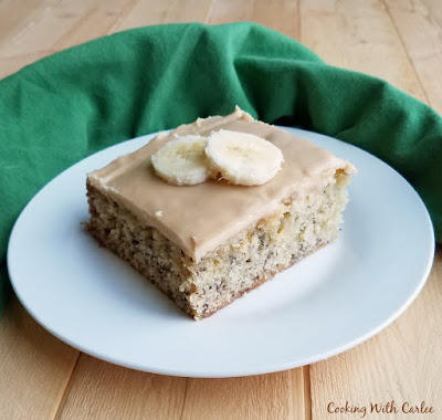 banana cake topped with caramel frosting and banana slices