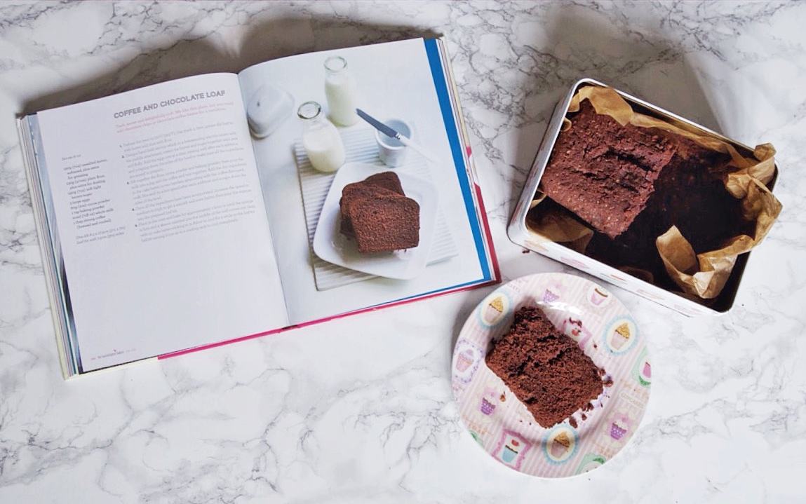 Flatlay of recipe book and chocolate cake