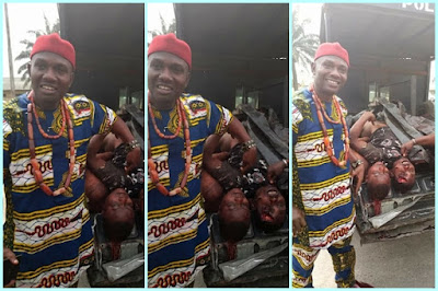 Man shows off his teeth as he poses with Don Waney's corpse in Port Harcourt