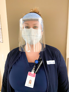 a nurse models the face shield