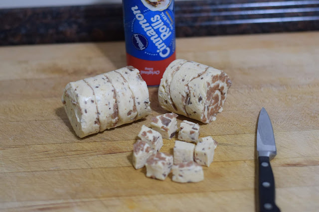 The canned cinnamon rolls cut into 9 small, bite-sized pieces.