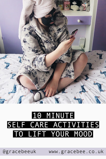 "Grace is sitting on the bed in her dressing gown. Below her is text that reads ""10 minute self care activities to lift your mood"