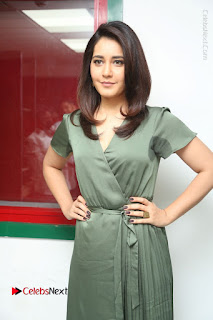 Actress Raashi Khanna Stills in Green Short Dress at Mirchi 95 Suno Aur Mercedes Jeeto Contest  0083.JPG