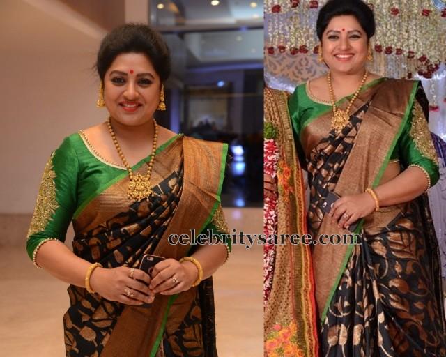 dd9616cd64b66 TV Actress Sana wearing black uppada silk saree with gold sari mango leaves  floral design all over and gold border