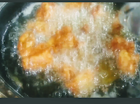 Frying chicken pieces in oil for chicken fry recipe