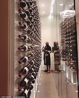 Mayweather shows off his wine collection in his mansion in Beverly Hills