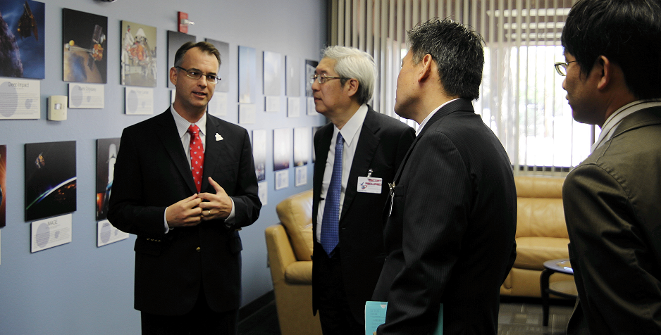 OSIRIS-REx Principal Investigator Dante Lauretta discusses the UA's long history of involvement in NASA planetary missions with colleagues from the Japanese space agency JAXA. (Photo: Ross Dubois)