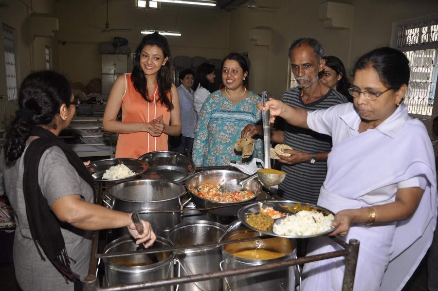 Kajal Agarwal Birthday Celebration Stills In Orange Top White Jeans