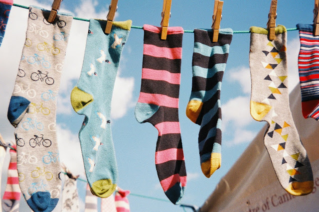 socks drying on line:Photo by Nick Page on Unsplash