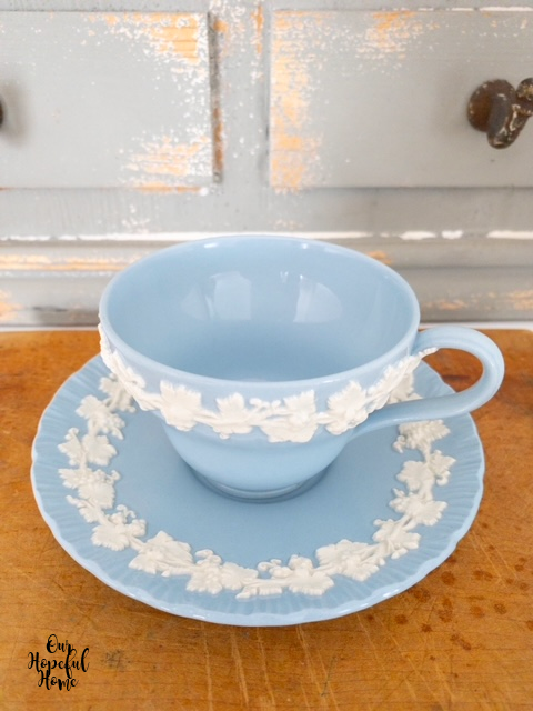 blue cup plate white embossed flowers