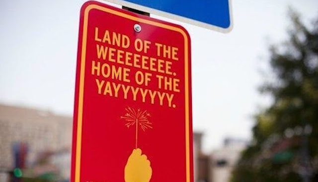 Street sign Land of the WEEEE home of the YAYYYY. Snark on the 4th and other stories about Merica. marchmatron.com