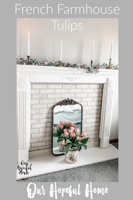 salvaged fireplace mantel pink tulips French mirror Valentine's day decor