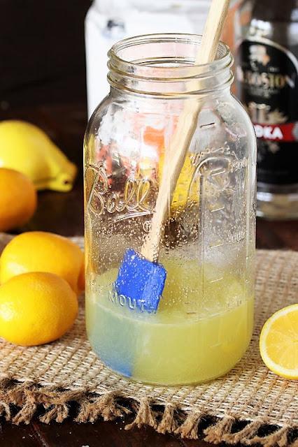 Dissolving Sugar to Make Homemade Hard Lemonade Image