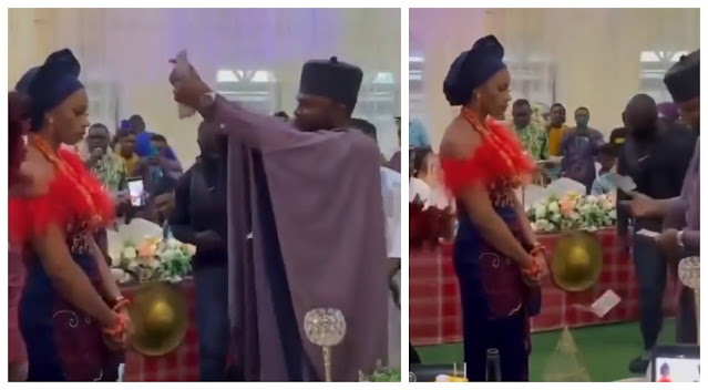 Moment Bride refuses to smile as her husband sprays her Naira notes at their traditional wedding (Video)