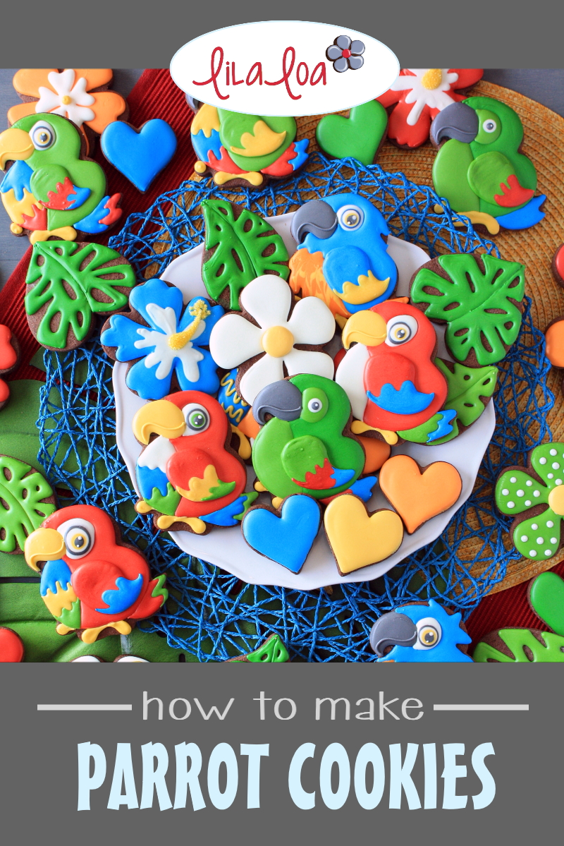 Brightly colored tropical jungle parrot, flower, and leaf decorated sugar cookies - a cookie decorating tutorial with video