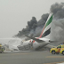Watch the terrifying moment 300 passengers flee Emirates plane moments before it burst into flames after crash landing in Dubai