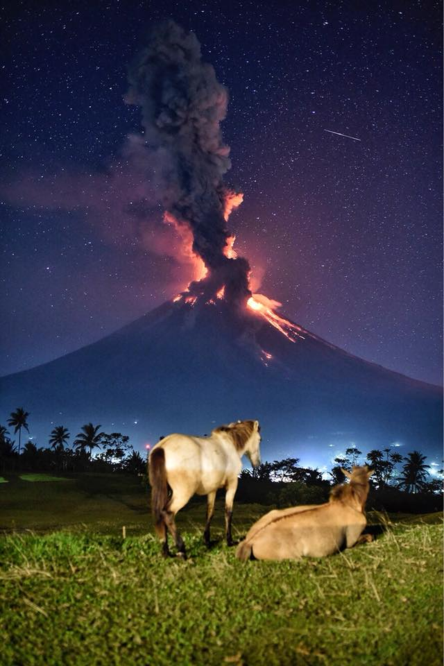 Mayon Volcano explodes as seen from Camalig, Albay on January 23