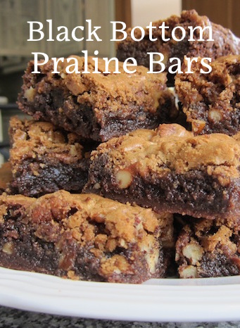 Food Lust People Love: These guys are called Black Bottom Pecan Praline Bars and they are a big chocolately chewy, crunchy stack of evil. Make some to take to a friend's house. You probably shouldn't be alone in your house with them. Fair warning.