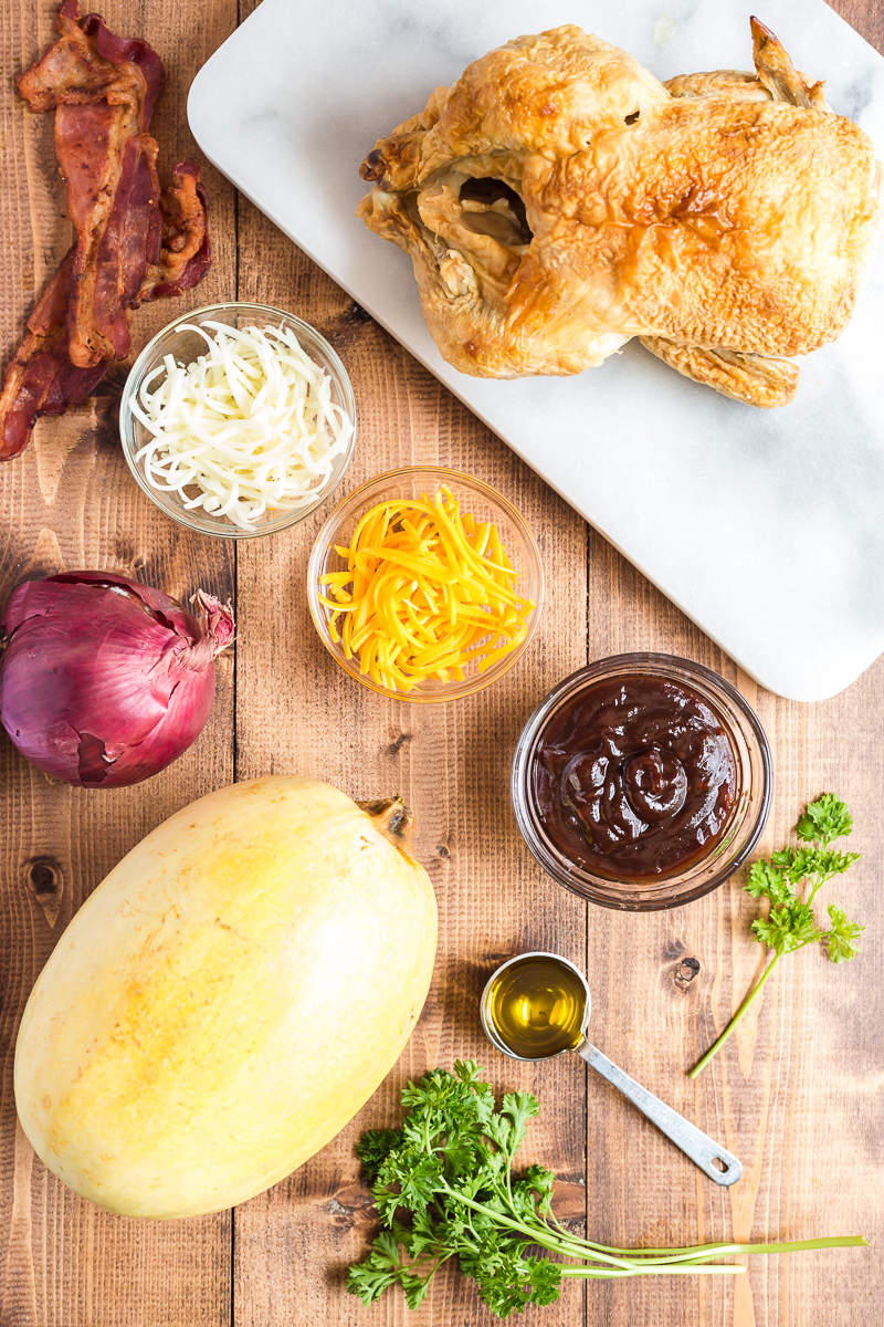 This BBQ Chicken Spaghetti Squash is the perfect low carb way to enjoy your favorite pizza flavors. #lowcarb #keto #glutenfree #spaghettisquash #BBQ #Barbecue #chicken #recipe   bobbiskozykitchen.com